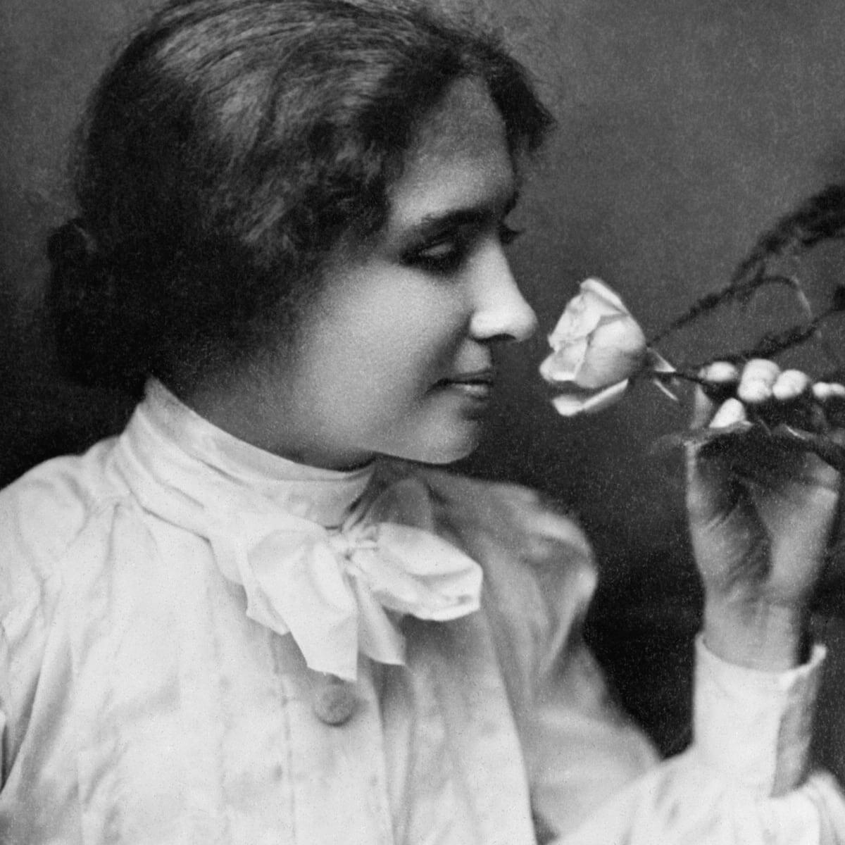Helen Keller smelling a rose
